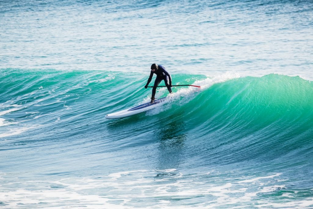 man on top of a wave