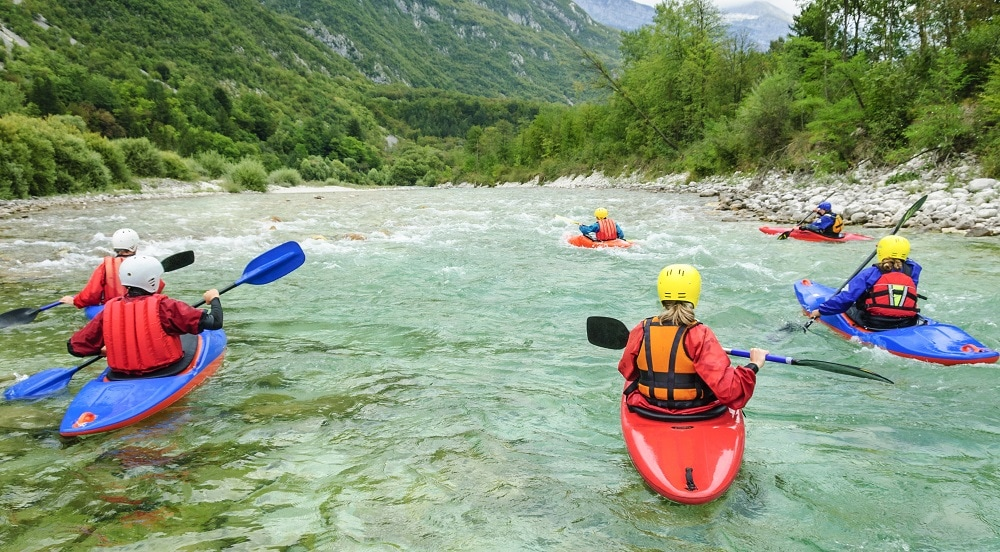 kayak group going down a river
